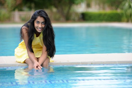 traditionally indian: indian Girl enjoying summer at pool  Stock Photo