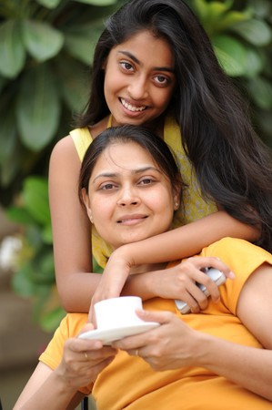 Mother relaxing with daughter