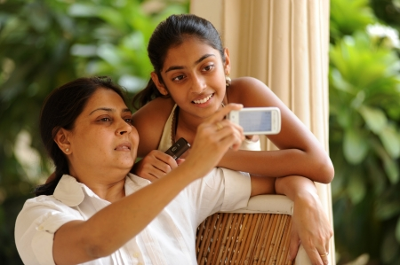 indian youth: mother and daughter having fun