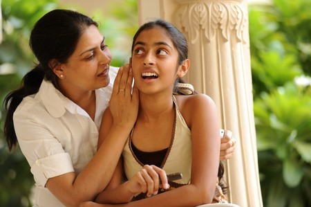 mother and daughter telling secret