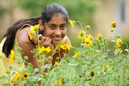subcontinent: indian beautiful girl enjoying domestic garden Stock Photo