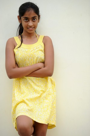traditionally indian: indian beautiful girl posing at outdoor yellow wall