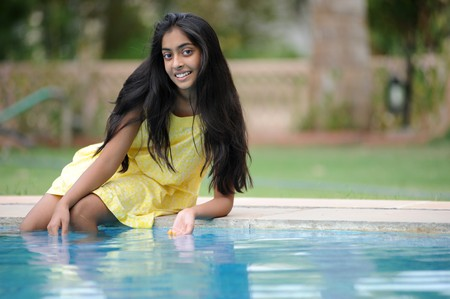 indian subcontinent ethnicity: indian Girl enjoying summer at pool