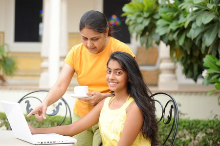 Mother and daughter working on laptop in outdoors Stock Photo - 7298725