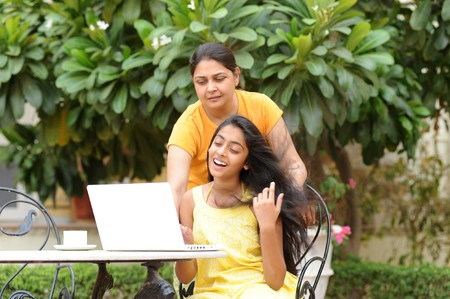 Mother and daughter working on laptop in outdoors Stock Photo - 7298706