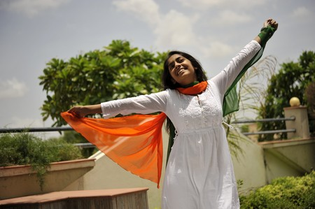 saffron: indian girl expressing freedom with stretching arms