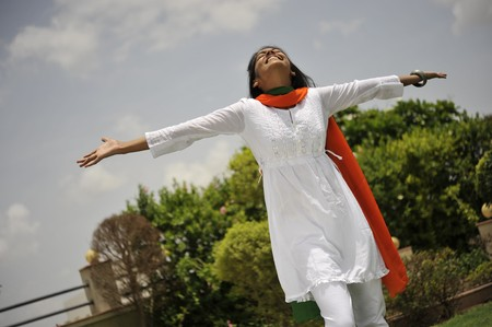 indian girl expressing freedom with stretching arms photo