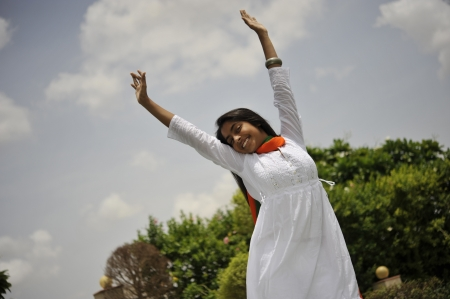 indian girl expressing freedom wearing tri color photo