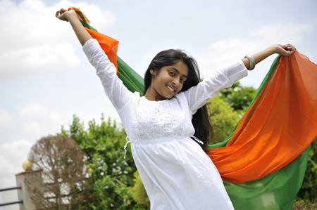 saffron: indian girl celebrating indian independence day