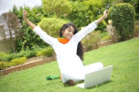 traditionally indian: girl working on laptop enjoying freedom Stock Photo