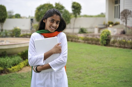 traditionally indian: indian girl holding laptop outdoors