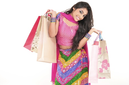 adult indian: Attractive Indian Girl With Hands Full of Shopping Bags