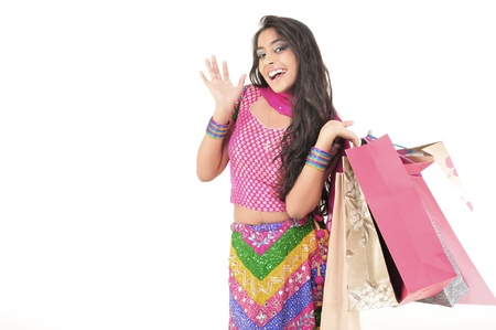 Indian Young girl wearing ethnic Holding Shopping Bags Stock Photo - 15719915
