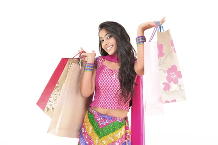 teenage girl dress: Indian Young girl wearing ethnic Holding Shopping Bags