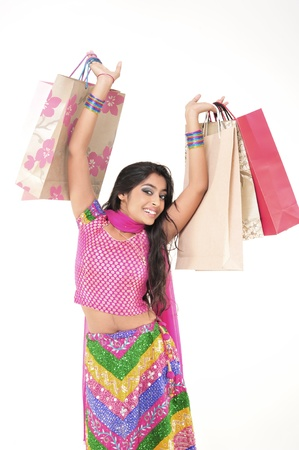 Indian Young girl wearing ethnic showing Shopping Bags