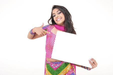 promotion girl: Excited Indian Girl Showing Blank Card  Stock Photo