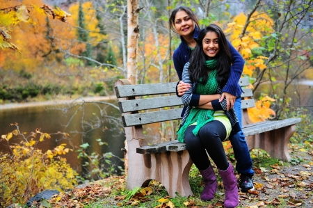 A mother and daughter enjoying a day at the autumn park photo