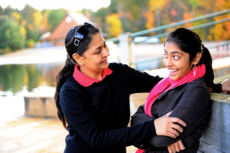 traditionally indian: Loving mother and daughter talking to each other in outdoors