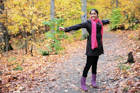 emotional freedom: Indian girl showing expression in autumn park