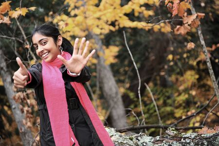 emotional freedom: happy young indian girl enjoying autumn Stock Photo