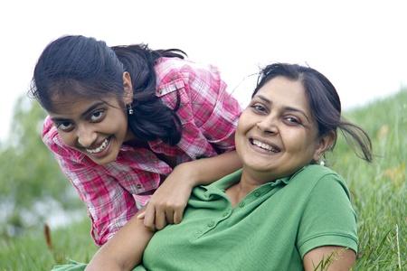 Loving mother daughter enjoying in park photo