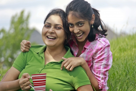 traditionally indian: Loving mother daughter enjoying in park