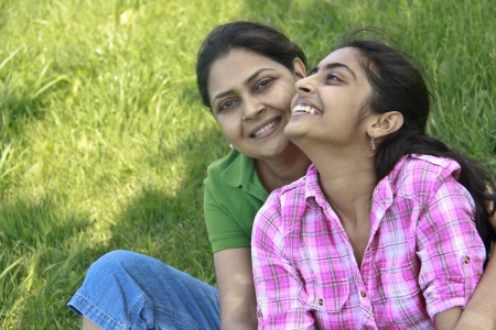 Loving mother daughter enjoying in park photo