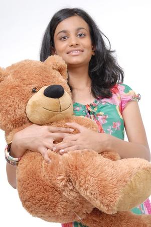 teddybear: Indian pretty girl with teddy bear in an embrance Stock Photo