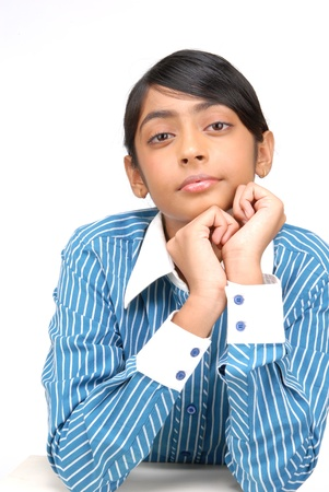 young school girl sitting at the desk, her chin resting on her hands Stock Photo - 16495139