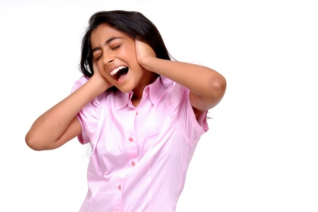 tense: Young Indian Girl Closing ears with hands and screws up her eyes Stock Photo
