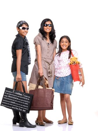 Trendy young girls with shopping bags  photo