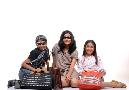 indian style sitting: Trendy young girls with shopping bags