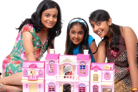 Group of three girls playing with doll house Stock Photo - 16672595
