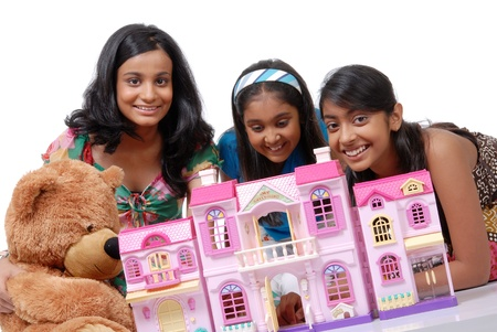 doll house: Group of three girls playing with doll house