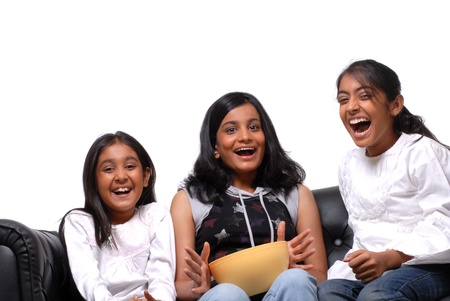 13 15 years: Group of Indian Girls watching TV