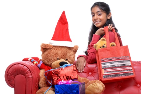 Pretty Indian girl with Teddy Bear at Christmas  photo