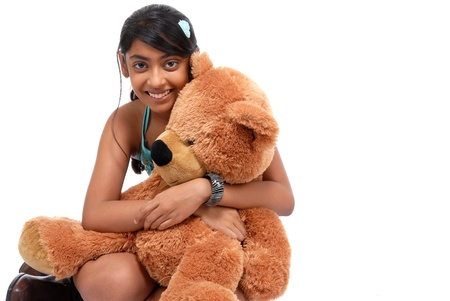 Girl with Teddy-bear in an embrace  photo