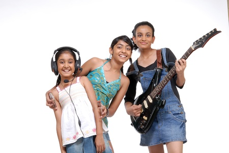 girl playing guitar: Indian girls music band over white background