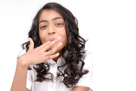 finger licking: Girl licking her fingers over white background  Stock Photo