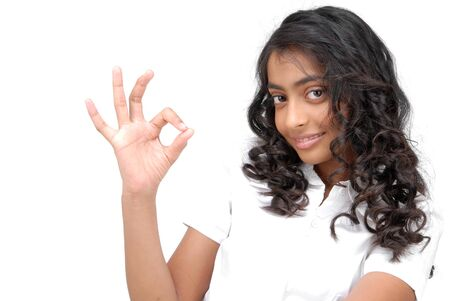 ok hand: Happy girl making an OK sign over white background