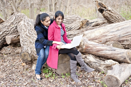 Indian loving mother and daughter in outdoors photo