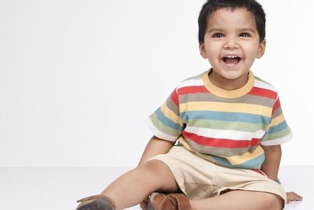 Happy little indian boy in indoor Banco de Imagens