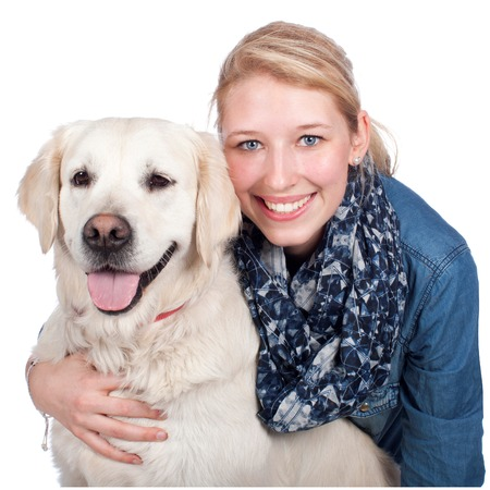 Happy woman with Golden Retriever dog