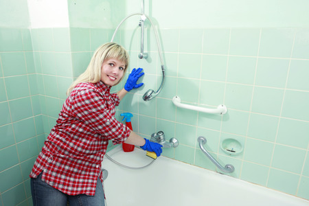 calcification: woman cleaning an old dirty bathroom