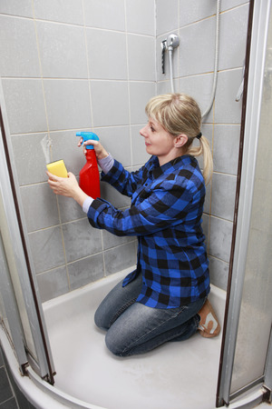 woman cleaning an old dirty bathroom