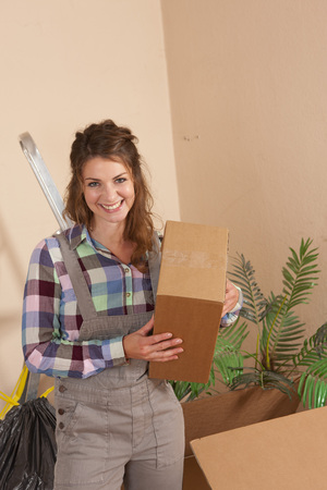 moving box: Happy woman with moving box