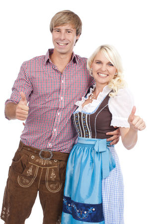 traditional costume: young couple in traditional costume with thumbs up Stock Photo