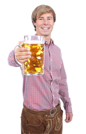prost: Young bavarian man with beer glass Stock Photo