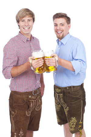 prost: Two young bavarian men with beer glasses Stock Photo