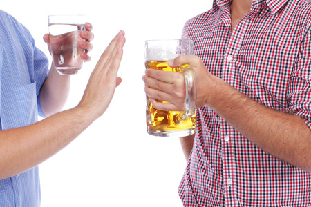 Two men with beer and mineral water Stockfoto